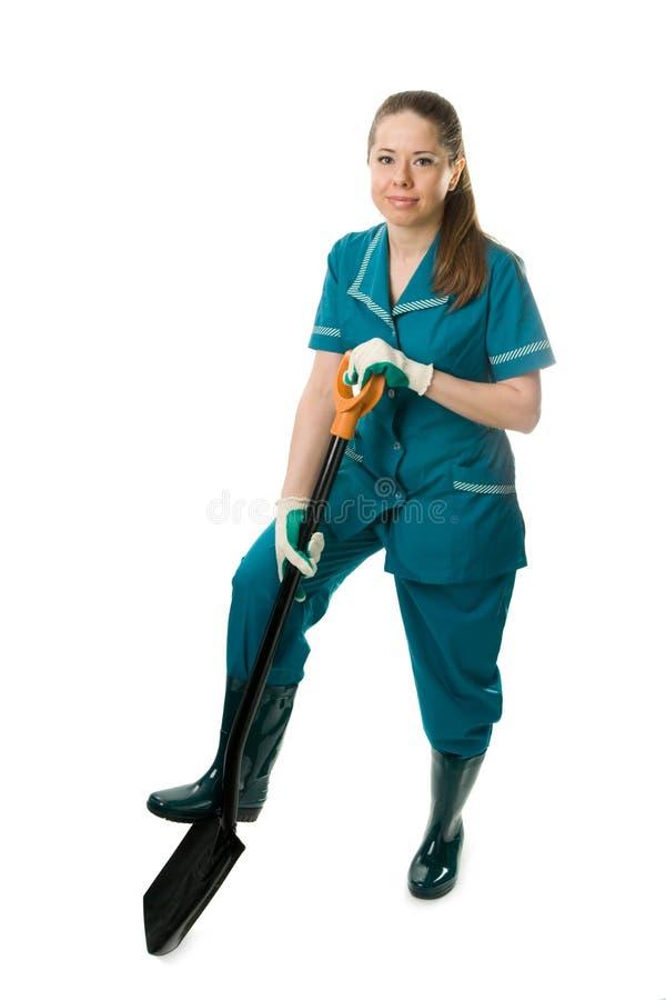 Een vrouw met spade stock afbeelding