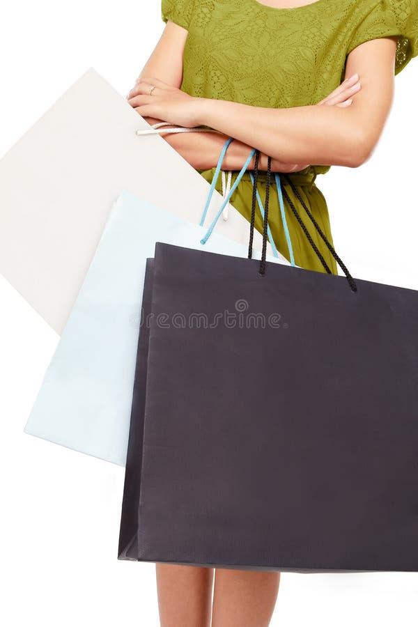 Een vrouw met veel het winkelen zakken royalty-vrije stock afbeeldingen