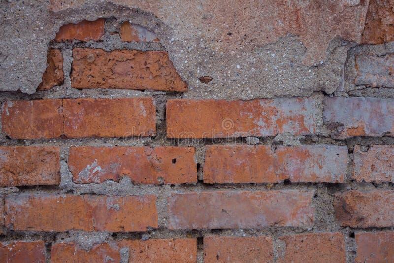 Een vuile bakstenen muur stock afbeelding