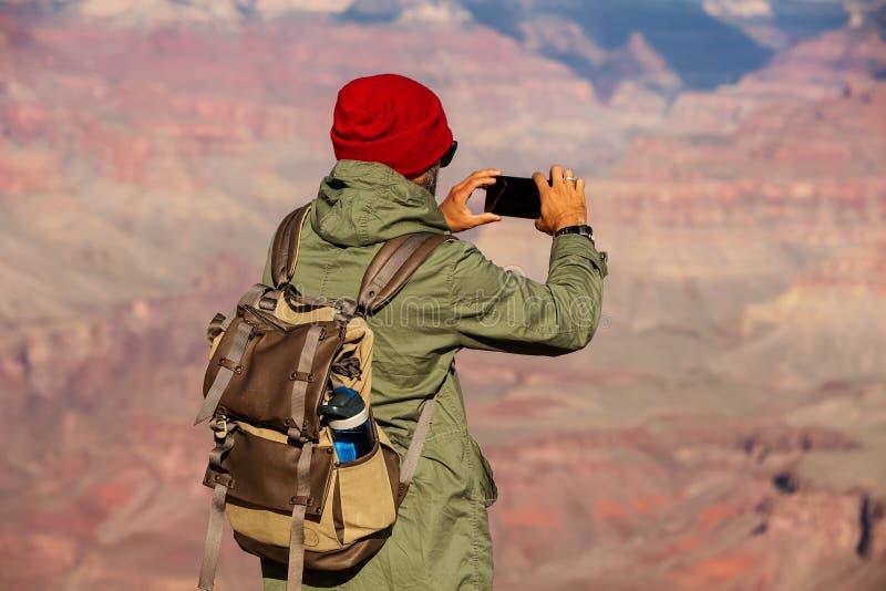 Een wandelaar in het Nationale Park van Grand Canyon, Zuidenrand, Arizona, de V.S. stock afbeelding