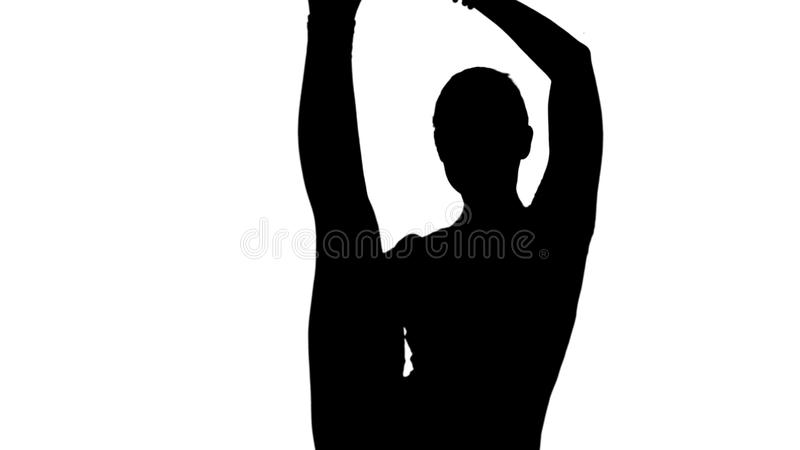 Een yogapositie voor zich saldo en het uitrekken, vrouw die het spoorsteen uitoefenen van Utthita Hasta Padangustasana royalty-vrije stock afbeelding