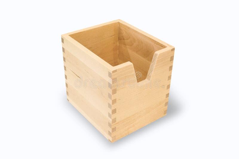 Een zachte houten doos rust op een witte achtergrond royalty-vrije stock fotografie