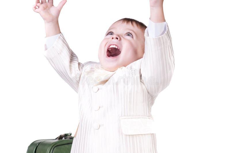 Een zeer leuke jonge verraste die jongen, op wit wordt geïsoleerd royalty-vrije stock afbeelding