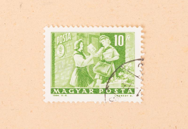 Een zegel in Hongarije wordt gedrukt toont de Hongaarse portdienst, circa 1964 die stock afbeeldingen