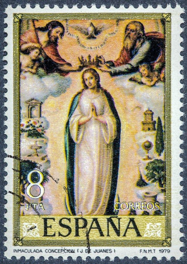 Een zegel in Spanje wordt gedrukt toont Inmaculada Concepcion door Juan de Juanes dat royalty-vrije stock foto