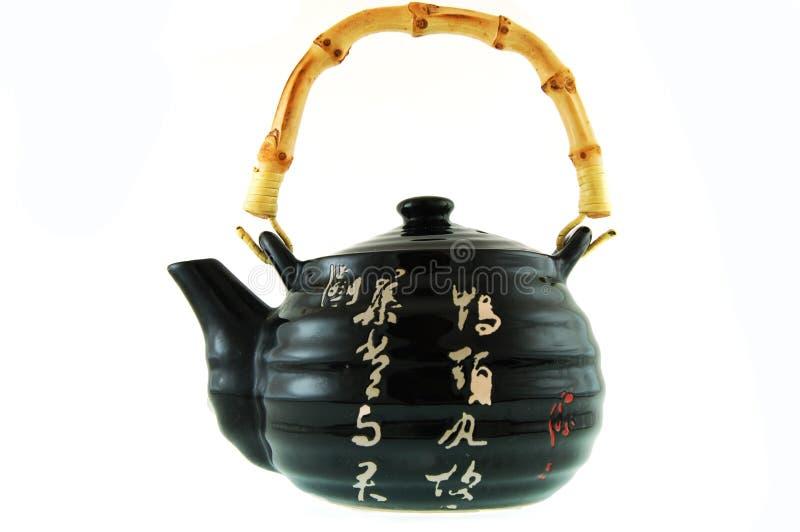 Een zwarte ceramische theepot stock foto's