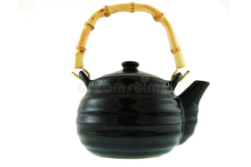 Een zwarte ceramische theepot royalty-vrije stock afbeelding