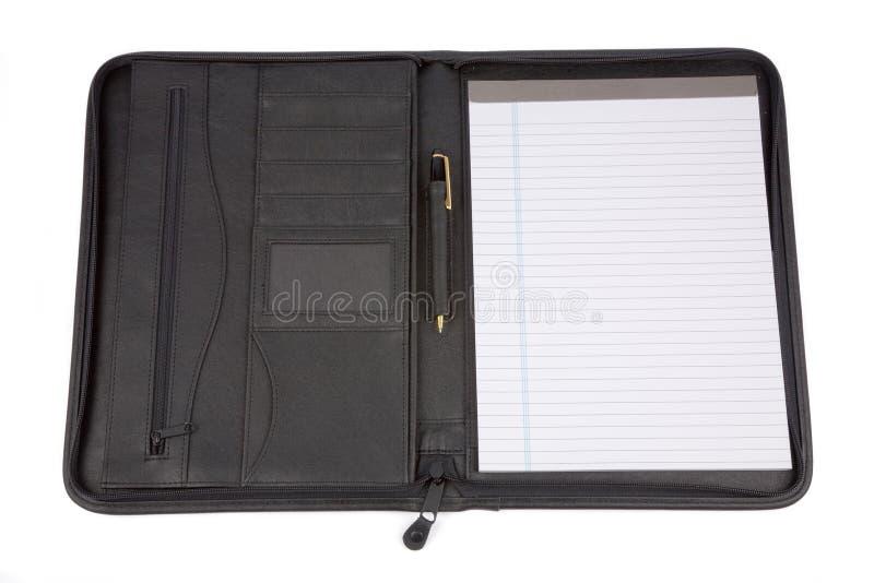 Een zwarte padfolio stock afbeelding