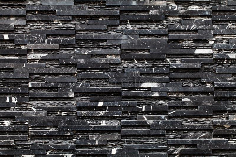 Een zwarte steenmuur stock afbeeldingen