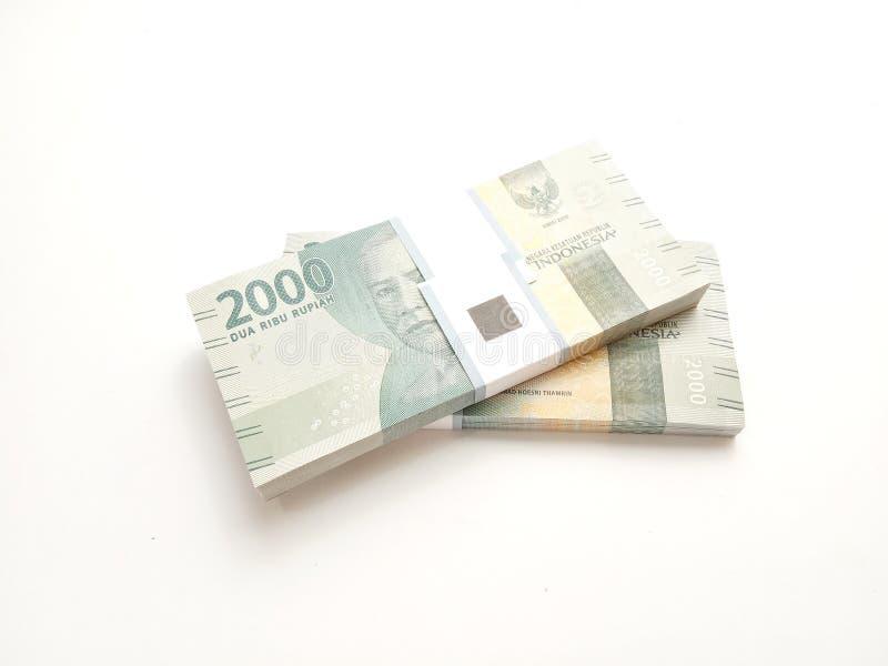 Eenvoudige Foto, Hoogste Weergeven, Pakken van het Geld van Roepieindonesië, 2000, bij witte achtergrond stock foto