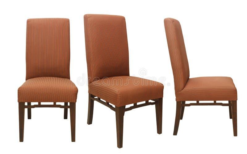 Eenvoudige stoelen van verschillende die mening op witte achtergrond wordt geïsoleerd stock afbeeldingen
