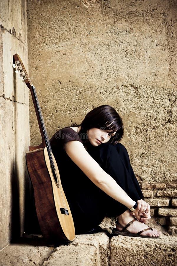 Eenzame gitarist royalty-vrije stock foto's