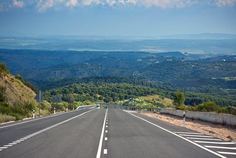 Eenzame weg in $ce-andalusisch bergen, Spanje royalty-vrije stock foto