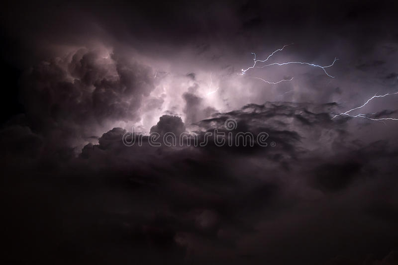 Eerie Lightning. With dramatic cloud formations alluminating night sky stock images