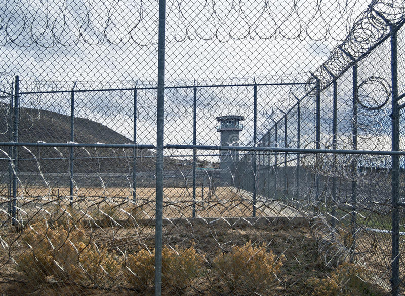 Eerie view, Historic Nevada State Prison, Carson City. Razor wire and guard tower, old Nevada State Prison in Carson City, Nevada royalty free stock photography