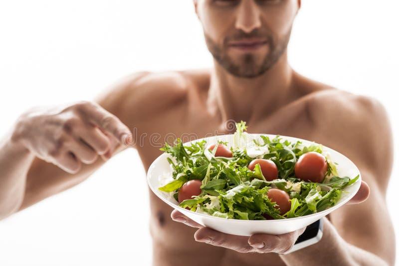 Eet groenten en ben geschikt royalty-vrije stock afbeeldingen