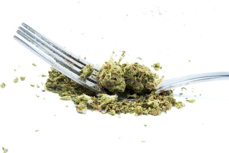 Eetbaar Marihuana, Vork en Mes, Witte Achtergrond royalty-vrije stock foto's
