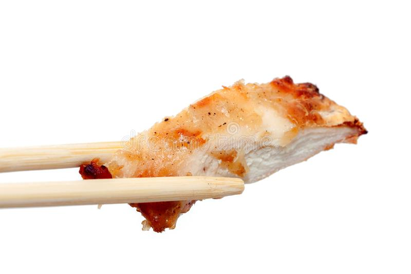 Eetstokje en kippenborst met saus stock afbeeldingen