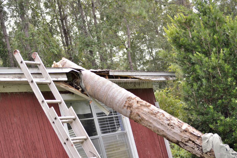 EF0 tornado damage on house roof royalty free stock photo