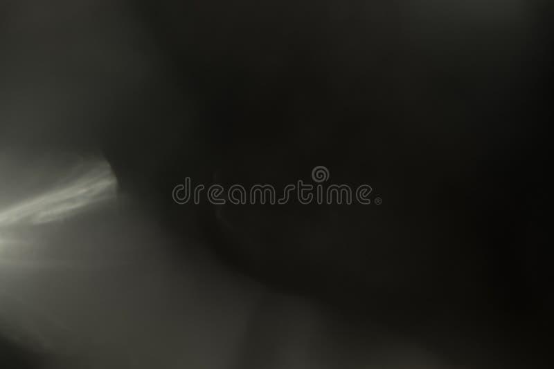 Efecto luminoso de la llamarada real de la lente Escape de Ray imagen de archivo