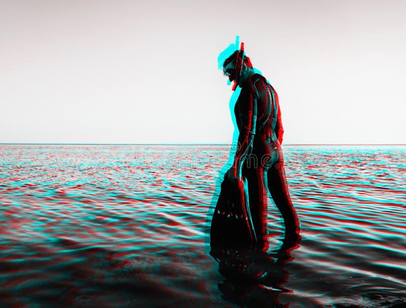 Efeito do Anaglyph do homem em um terno de mergulho com aletas imagem de stock