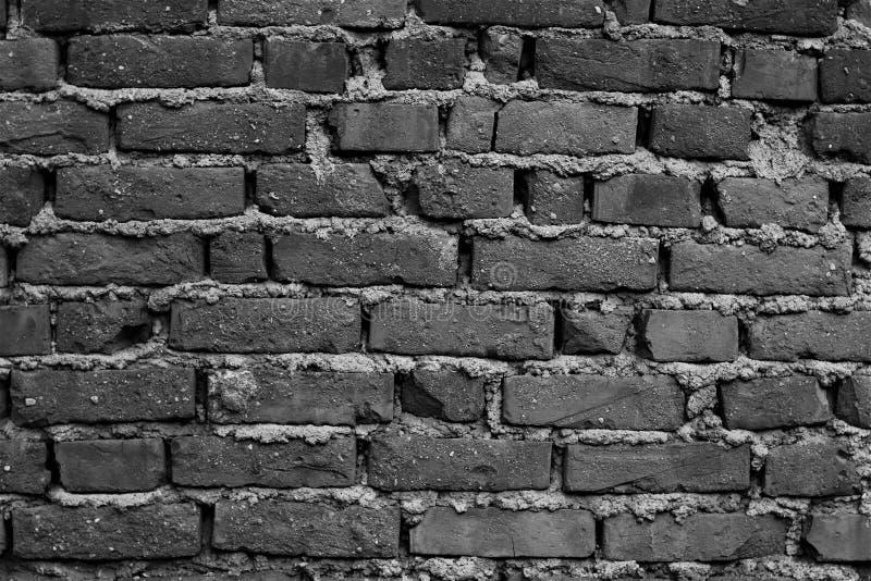 Efeito escuro fundo envelhecido da parede de tijolo fotografia de stock