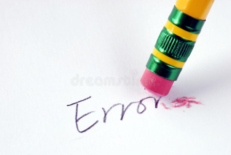 Effacez l'erreur de mot avec un caoutchouc images libres de droits