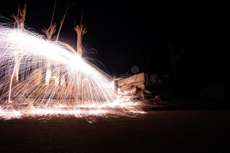 Effect of sparks of incandescent steel. Long exposure photo. Fire wall in the abandoned city of Epecuen. Effect of sparks of incandescent steel. Long exposure stock images