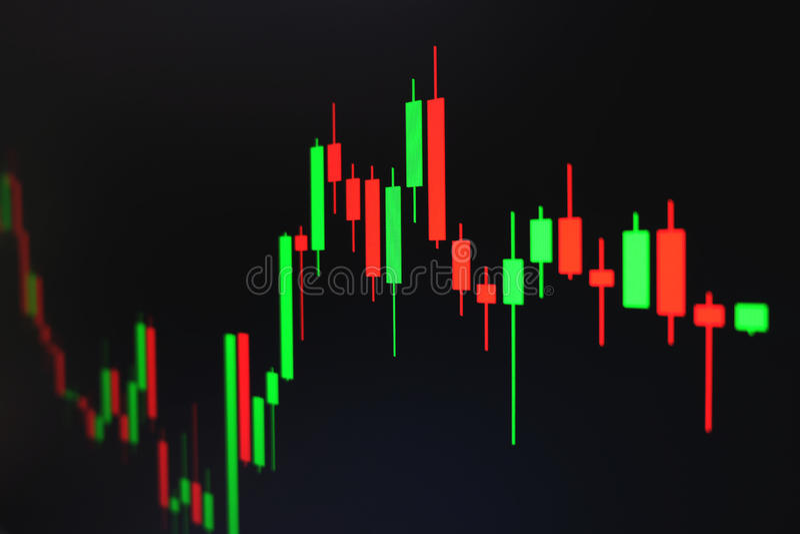 Effectenbeurs groene en rode grafiek met zwarte achtergrond, Forex markt, handel stock foto