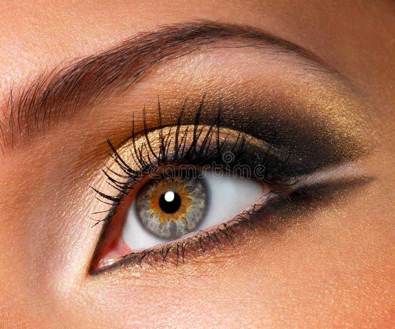 Effective golden-brown make-up stock photos