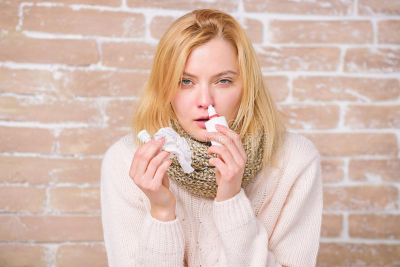 Effective nasal spray. Runny nose and other symptoms of cold. Nasal drops plastic bottle. Nasal spray runny nose remedy. Girl sick person hold nasal drops and stock photos