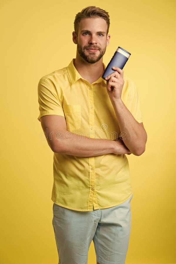 Effective shampoo. Try this shampoo. Best shampoo for your hair type. Make hair stronger and more resilient. Man stock image