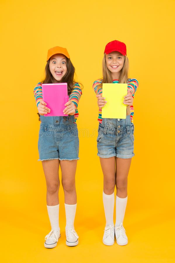 Effective study groups help students learn material deeper. Kids girls with books study together. Study group can help. Solidify and clarify material. Back to royalty free stock photos