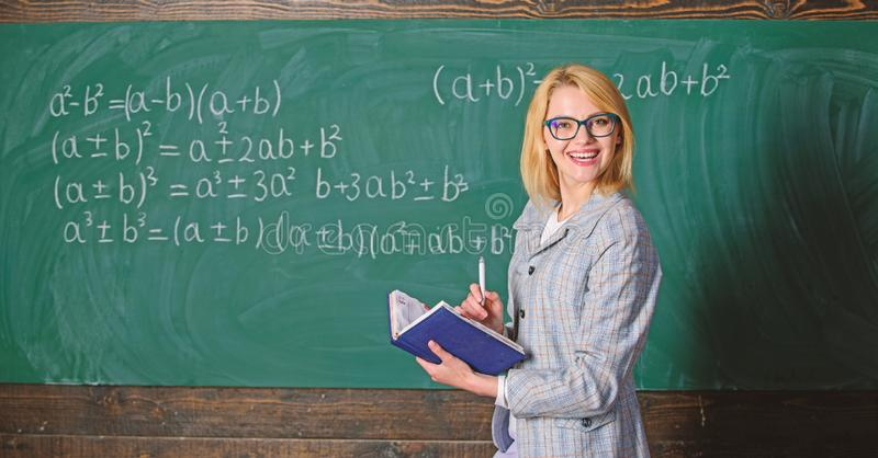 Effective teaching involve acquiring relevant knowledge. Woman teaching near chalkboard in classroom. Qualities that. Make good teacher. Effective teaching stock photo