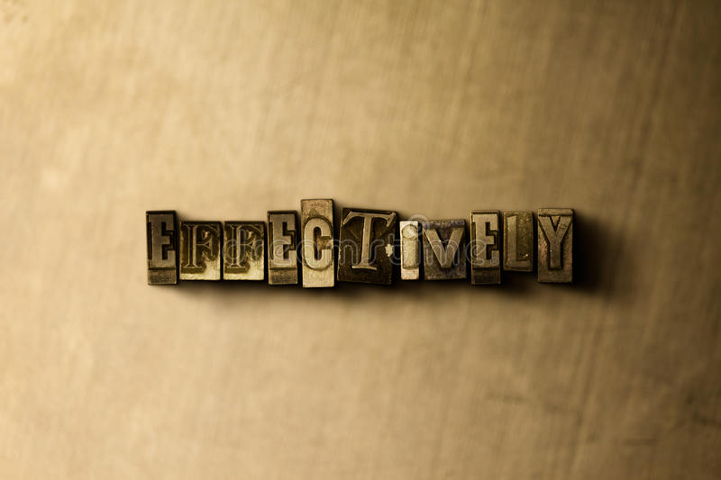 EFFECTIVELY - close-up of grungy vintage typeset word on metal backdrop. Royalty free stock illustration. Can be used for online banner ads and direct mail stock photo