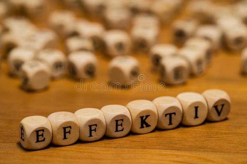Effectively written with wood cubes in german royalty free stock photography