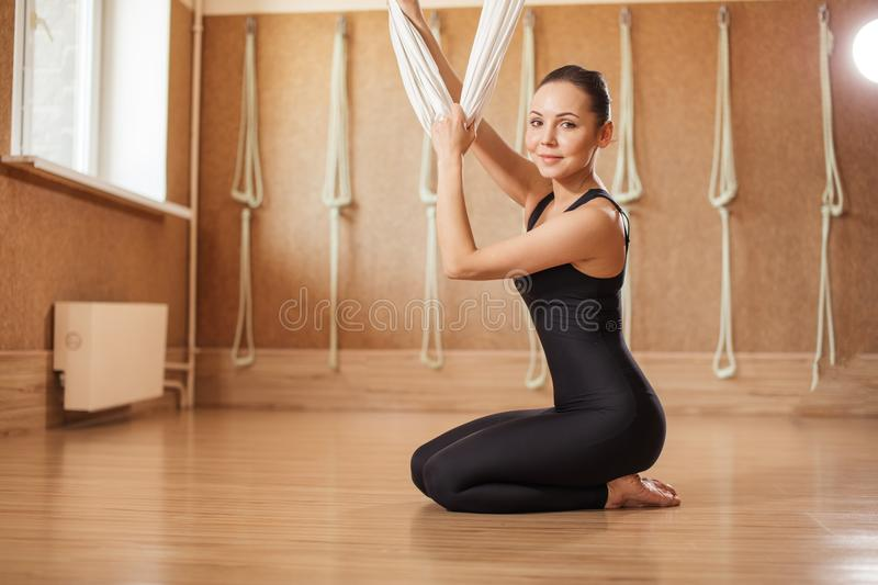 Effectiveness of aerial yoga in improving general health. Full length photo stock photography