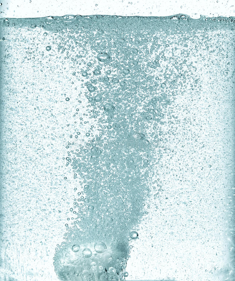 Effervescent dissolving fizzy tablet in water. Effervescent dissolving fizzy tablet in a water stock photography