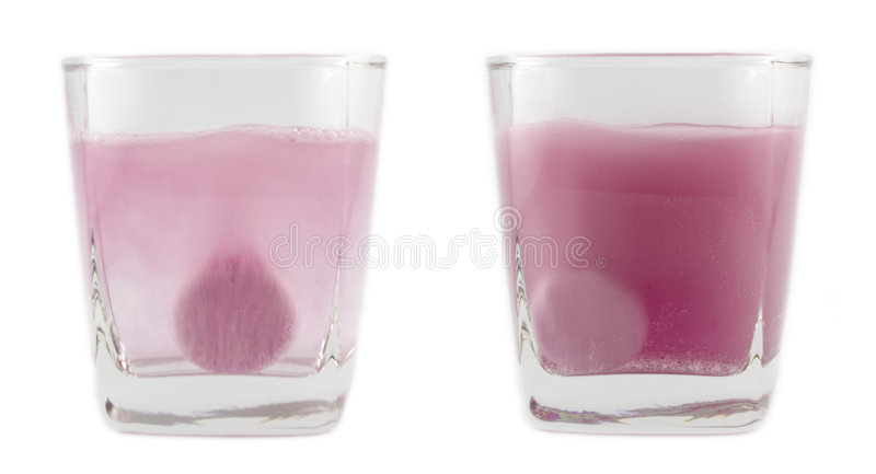 Effervescent tablet. Dissolving in water royalty free stock image