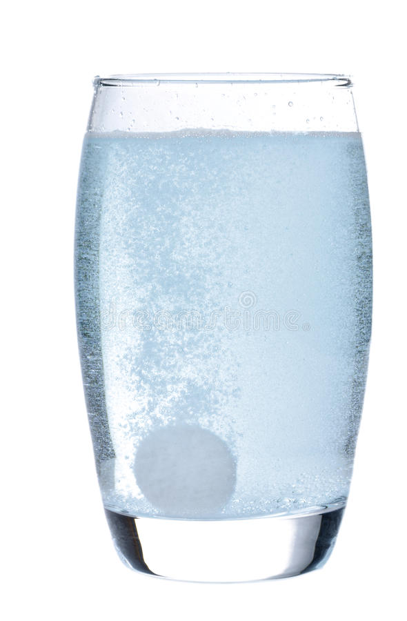 Effervescent tablet in glass with water stock photos