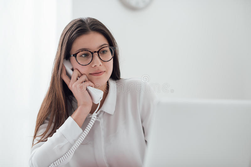 Efficient secretary on the phone royalty free stock images