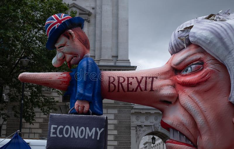 Effigy of Theresa May dressed as Pinocchio, photographed during the `March for Change` anti-Brexit protest in London. UK, July 20, 2019 stock photography