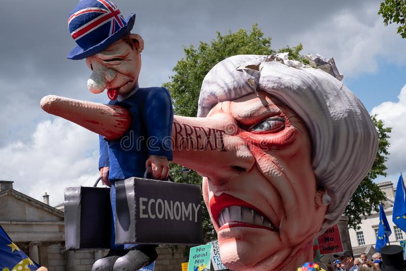 Effigy of Theresa May dressed as Pinocchio, photographed during the `March for Change` anti-Brexit protest in London. UK, July 20, 2019 stock photo