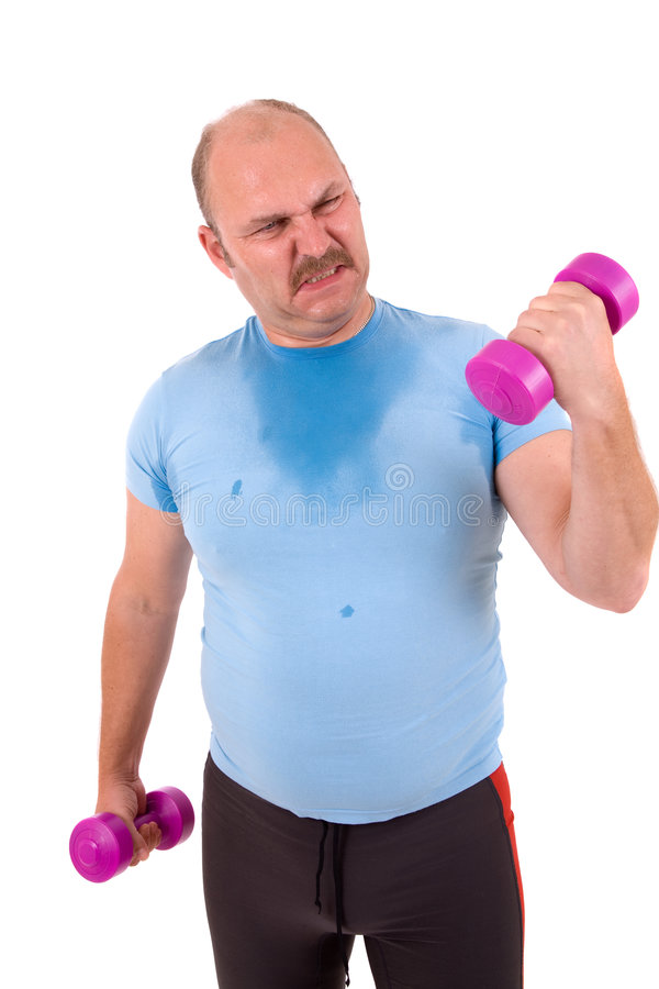Effort. Mature male trying to lift one kilo weights with a lot of effort stock photo
