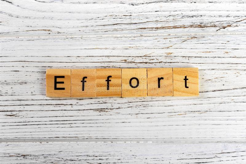 EFFORT word made with wooden blocks concept stock image