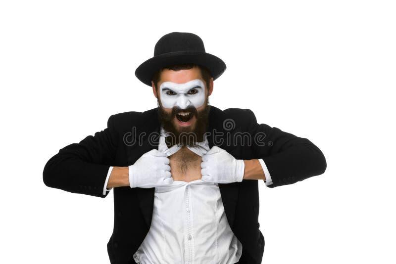 Efterapa som en affärsman som river av hans skjorta fotografering för bildbyråer