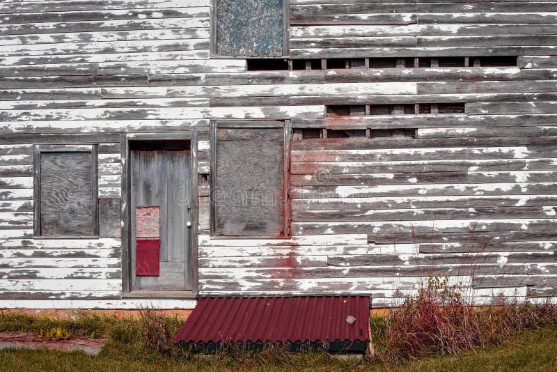 Eftersatt nedskärningbyggnadsabstrakt begrepp royaltyfri fotografi