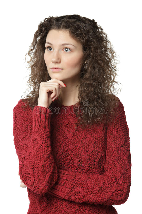 Eftertänksam kvinnlig i tröja royaltyfri bild