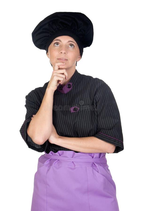 eftertänksam nätt kvinna för kockuttryck arkivfoto