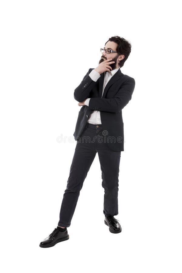 Eftertänksam skäggig affärsman arkivfoto